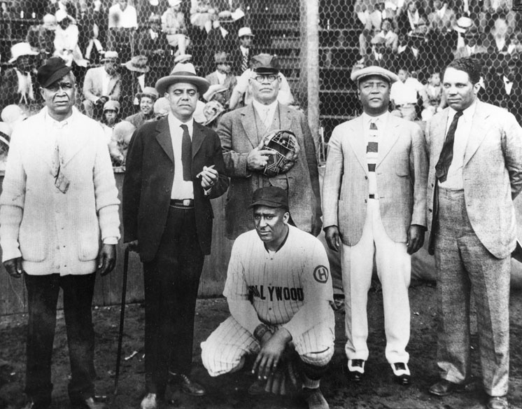 A Photograph Of A Group Of Baseball Players And Businessmen